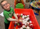 Our sensory table is changed with each session and is a favorite activity for the kids